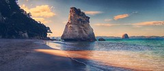 Cathedral Cove (FlavioSarescia) Tags: ocean travel sunset sea newzealand sun mountain reflection nature water sunshine landscape rocks walk sony famous hike wanderlust narnia northisland cinematic downunder cathedralcove