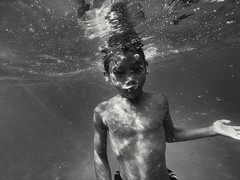 Going Under (photo-razzo) Tags: boy sea blackandwhite water swim asian southeastasia underwater child availablelight nationalgeographic humaninterest gopro blackedition flickraward goprohero3 discoveryphotos goprohero3blackedition
