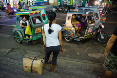 Ride home (RM Ampongan) Tags: life street city red home night photography evening ride tricycle cab philippines streetphotography going human sur activity region bicol camarines iriga