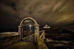 Otro famoso tras ls rejas. (Alfix61) Tags: lighthouse night canon faro noche nubes nocturna largaexposicin fotografianocturna alfix