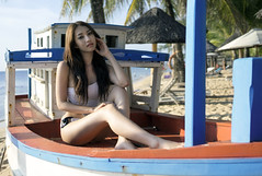 Dream Boat (TheAngryBrain) Tags: portrait people sunlight beach water girl beautiful zeiss landscape asian daylight seaside model glamour sand pretty vietnamese outdoor sony naturallight resort vietnam bikini shore hanoi swimsuit saigon hochiminhcity phuquoc xinh vinpearl baisao a6000