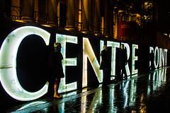 Centre Point (yellow-cake) Tags: london wet rain sign night canon dark point photography lights centre trafalgar trafalgarsquare lumiere lightart luminaire ef24105mm14usm