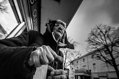 A fist full of life (pootlepod) Tags: life street portrait blackandwhite woman monochrome face closeup lady photography hands candid joy happiness ticket elderly fist hood individual femal canon60d stphotographia