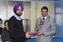 Mr. Gurvinder Singh Kang MD of West Highlander ,Chandigarh  giving performer of the month award to Harwinder Singh