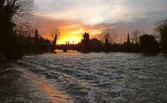 Sunset at Dobbs Weir, near Hoddesdon, with the River Lea Navigation running higher than normal.  10 01 2016 (pnb511) Tags: trees sunset sky orange reflection water silhouette river waves glow lee lea hertfordshire herts