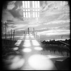 La Sagrada Barceloneta (La T / Tiziana Nanni) Tags: city travel bw film cityscape double analogue viaggi barcellona biancoenero 120mm filmscan pellicola multiesposizione analogico holga120gn iamyou tizianananni