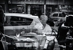 Were we live and die in the city life (BotaFriko) Tags: blackandwhite reflection window car streetphotography busy crowdy