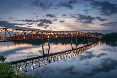 """""""Dawn is the time when nothing breathes, the hour of silence. Everything is transfixed, only the light moves. - Leonora Carrington (spareaccmok) Tags: bridge reflection water by clouds dawn still singapore time punggol passing"""