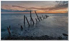Drummore groins#4 (Hugh Stanton) Tags: sunrise boat shoreline groins