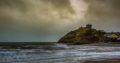 Stormy scene at Criccieth Castle (christaff1010) Tags: uk sea sky panorama sunlight seascape green castle beach water rain wales clouds landscape coast seaside unitedkingdom britain hills shore gb gwynedd criccieth