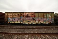 SEM (TheGraffitiHunters) Tags: street pink blue black art yellow train graffiti big colorful paint tracks spray boxcar freight benched benching