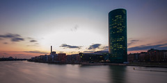 Frankfurt Westhafen III (jeglikerikkefisk) Tags: city sunset building sonnenuntergang hessen frankfurt main filter stadt nd ufer fluss westhafen frankfurtammain neubau hochhaus hesse ffm langzeitbelichtung frankfurtam geripptes