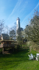 tree house (loonatic) Tags: blue sky lighthouse green netherlands europe chairs lawn nederland treehouse friesland schiermonnikoog