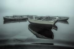 Reflections in the mist (grbush) Tags: uk sea england bw mist lake reflection water monochrome fog boats lumix boat blackwhite fishing flood jetty panasonic shore ripples g3 fishingboat rowingboat lumixg