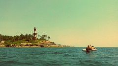 Kovalam beach, Kerala,India.............. (yadhukrishnan512) Tags: blue sea lighthouse love beach water by boat waves inspired
