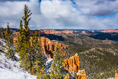 Bryce Canyon 11 (MarcCooper_1950) Tags: trees red sky orange snow colors clouds landscape utah nikon scenery rocks vivid canyon cliffs hills southern boulders hoodoo bryce rainfall hdr formations lightroom mounatins brycecanyonnationalpark geologic d810 marccooper