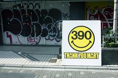 thank you mart (edwardpalmquist) Tags: street city travel urban smile sign japan graffiti tokyo shibuya harajuku takeshitastreet