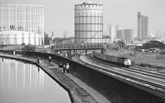Loco D1043  |  West London  |  1975 (keithwilde152) Tags: uk people blackandwhite london monochrome train landscape canal diesel outdoor tracks railway 1975 passenger locomotives scrubs wormwood thousands westerns d1043