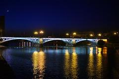 Siviglia Ponte di Triana (Marco Piumini) Tags: urban architecture night river sevilla spain open air bridges ponte urbano riflessi notte architettura spagna reflexes siviglia allaperto fiumi