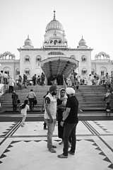 Sikh Temple (Mondmann) Tags: travel people bw india building architecture temple worship faith religion landmark pb barefoot indians sikhs sikh newdelhi sikhtemple gurudwarabanglasahib mondmann canonpowershotg7x