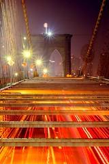The Furnace (Rommel Parada) Tags: street nyc longexposure nightphotography orange newyork cars architecture nightlights traffic availablelight tripod noflash nighttime transportation brooklynbridge lighttrails starburst afterdark roadway
