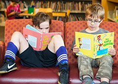 Well Read (evilpeacock) Tags: boy girl kids reading books couch seattlepubliclibrary brotherandsister drseuss fraternaltwins sevenyearold