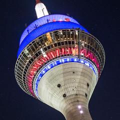 Rheintower at night (alxfink) Tags: blue red building tower architecture night circle lumix lights dsseldorf quadrat