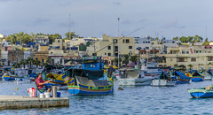 Gone Fishing (Preston Ashton) Tags: ocean blue sea sky man water buildings boats fishing fisherman waves malta rod