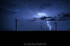 Windmills and Lightning (Black Mesa Images) Tags: storm black oklahoma rain weather hail night clouds texas stanley drought chase thunderstorm lightning prairie hooker harper tornado thunder mesa panhandle chasing spearman cimarron hardesty guymon supercell gruver goodwell
