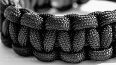 paracord (jamiemonsteroo) Tags: camera blackandwhite white black detail macro wide strap camerastrap paracord 500px ifttt