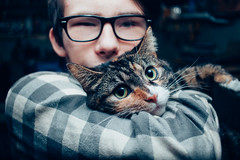 Crazy Willow with her Tiarnan (Kilkennycat) Tags: friends portrait people pets cat canon children child teen calico pancake 24mm 500d boywithcat boywithglasses kilkennycat t1i ryanconners