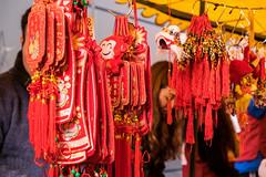 Good Luck Pendants (Sue_Hutton) Tags: winter colour manchester chinatown chinesenewyear redeye citycentre luckycharms yearofthemonkey february2016