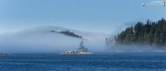Broken Islands under sea fog (dieLeuchtturms) Tags: sea canada fog america meer nebel britishcolumbia vancouverisland northamerica amerika kanada pazifik seafog barkleysound nordamerika brokengroup pacificrimnationalparkreserve seenebel 7x3 21x9 alberniclayoquotc 235x100