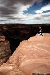 "Facing the Abyss with the Digital Device (Latter Day ""Christina's World"") (www.phileidenbergnoppe.com) Tags: arizona sandstone coloradoriver northernarizona glencanyon horseshoebend"