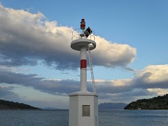 At the Old Epidauros's port. (Christos Andreou) Tags: lighthouse nature clouds port photography ngc naturalbeauty epidauros beautifulworld sealandscape seasunset hdrphotos spectacularphotos greekcoastline cloudylandscape nearbythesea samsunggalaxykzoomsamples opticalzoomphotos
