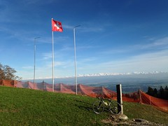 Swiss Flag Flapping In The Wind (collideous) Tags: blue sky alps bike evening spring view ride cross swiss flag gravel grinding 20042016