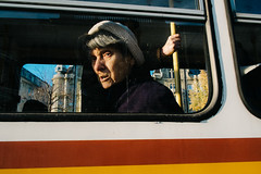 Budapest, Hungary 2015 (f.d. walker) Tags: street windows shadow woman sun sunlight color bus window face hat eyes women eyecontact europe hungary hand faces trolley candid budapest streetphotography streetportrait transportation easteurope easterneurope candidphotography