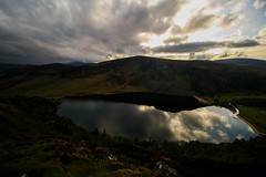 Sundown at Lough Tay (Adrian Costigan.) Tags: ireland sunset sky irish sun sunlight mountain lake water clouds canon reflections eos scenery lough sundown scenic tay wicklow loughtay