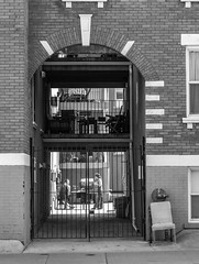 Guarded Conversation (Jay:Dee) Tags: city people urban bw white toronto black building brick photo gate walks parkdale topw topwpkdl