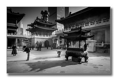 In the temple (Descended from Ding the Devil) Tags: china people blackandwhite bw monochrome buildings temple women shanghai outdoor devotion incenseburner photoborder