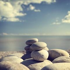 Stoned (Bruus UK) Tags: blue sea sky sculpture sun beach clouds coast marine natural stones creative pebbles devon shore balance budleigh salterton