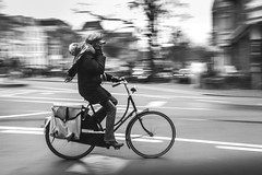 Bike panning (Per sterlund) Tags: street city bw amsterdam bike noiretblanc streetphotography panasonic streetphoto panning bnw baw 2016 gatufoto strasenfotografie panasonictz60