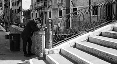 The Outdoor Office (Just Ard) Tags: street venice people blackandwhite bw italy white man black blancoynegro monochrome face writing person photography mono canal nikon noiretblanc zwartwit candid steps d750 unposed  biancoenero 24120mm schwarzundweis justard