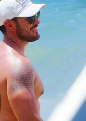 IMG_1212 (danimaniacs) Tags: shirtless man hot sexy guy beach smile pecs hat tattoo beard cap stud scruff mansolo