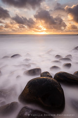 Some boulders (Camillo Berenos) Tags: longexposure england sunrise seascapes boulder boulders northumberland northsea silky slippy seascapephotography