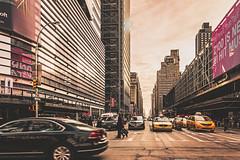 Streets of New York City (nureco) Tags: street city travel pink people usa sun building cars beautiful clouds big cityscape explore manhatten yellowcap godiscoverworld