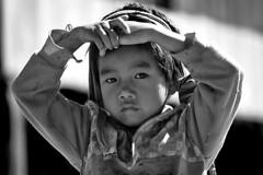 Myanmar (luca marella) Tags: life street portrait people bw film face analog blackwhite child burma documentary social bn biancoenero reportage birmania lucamarella