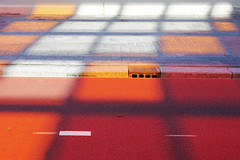 - shadow & colour - (Jacqueline ter Haar) Tags: shadow red orange colour station amsterdam centraal fietspad