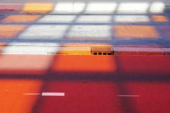 - shadow & colour - (Jacqueline ter Haar) Tags: shadow red orange colour station amsterdam explore tones centraal fietspad kleuren