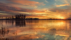 Strike of light 2 (piotrekfil) Tags: winter sunset sky lake reflection ice nature water clouds landscape pentax poland waterscape piotrfil